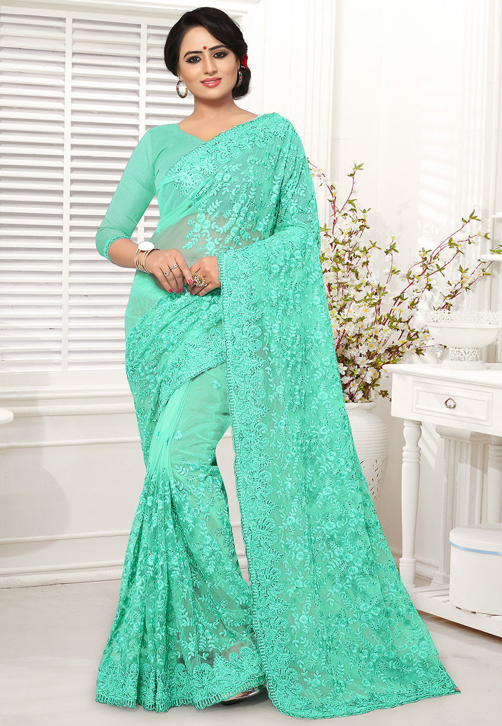Embroidered Net Lehenga In Peach Lqm76: Embroidered Net Saree In Turquoise : SCBA54