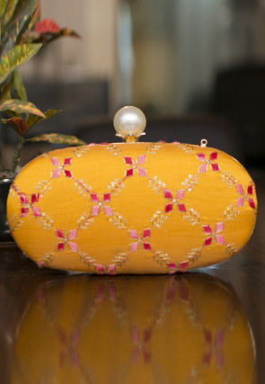 Embroidered Art Silk Oval Clutch Bag in Mustard