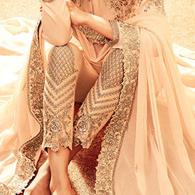 Explore salwar suits with embroidered and stylized bottoms for parties, weddings and festivals.