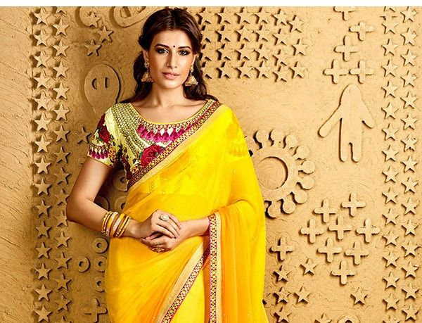 Yellow Bridal Ensembles in Stone work Sarees, Patch work Anarkalis, A-line Lehengas & more. Shop!